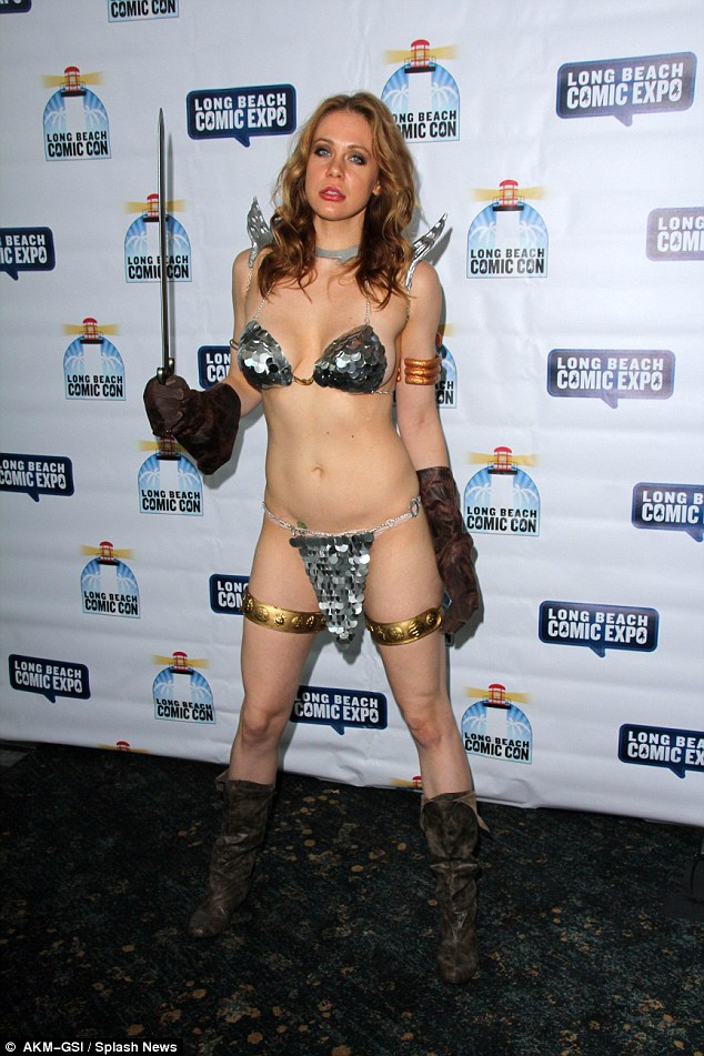 Got form: Last year she attended the event dressed as a warrior and flashed the flesh in a barely there chain mail string bikini