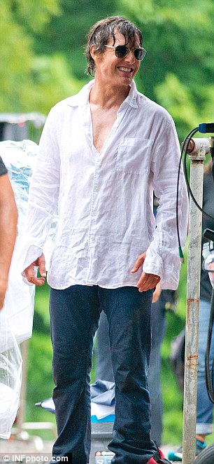 Mixing it up! The 53-year-old also sported wet hair, a wrinkled white shirt, and dark loose jeans