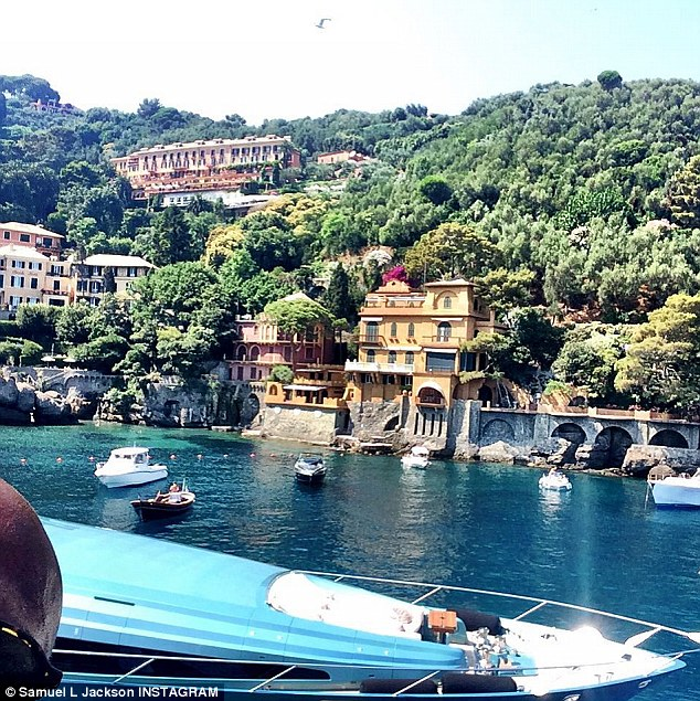 Pictured: The actor's head is in the bottom left corner in this selfie he took of the waterside buildings in Portofino