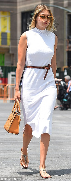Effortless: The daughter of Yolanda Foster looked chic in a mid-length white knitted dress and thing sandals