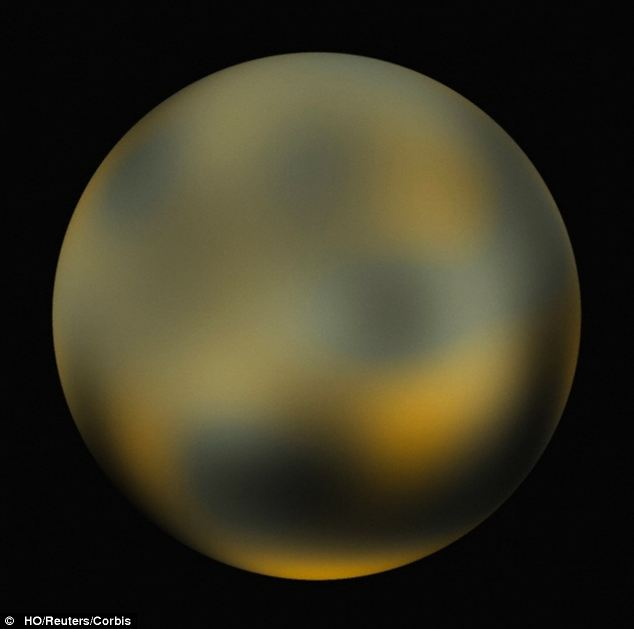 Astronomers in Spain believe Pluto (pictured) has yet another unusual feature - the world may be harbouring two supersized planets just out of reach of our telescopes. Researchers at the Complutense University of Madrid have found some strange patterns in the rocky objects around Pluto