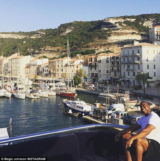 Vacay, yay! Johnson shared this photo of himself sitting on the yacht during a stop off in Corsica