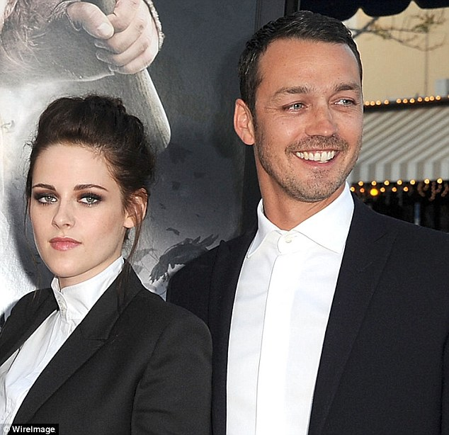 Serious scandal: In 2012, photographers captured Kristen getting cozy with director Rupert Sanders (right)