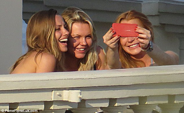 Say cheese: Lindsay and her girl friends grinned as she tried to snap the perfect shot