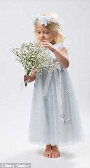 Lovely: A model shows off the version of the Princess dress chosen by Nicky Hilton for her wedding