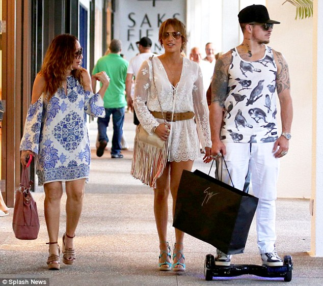 Fashionista: The 45-year-old singer later slipped into another feminine and flirty ensemble as she joined her toyboy beau, Casper Smart, 28, for more shopping at Bal Harbour Mall