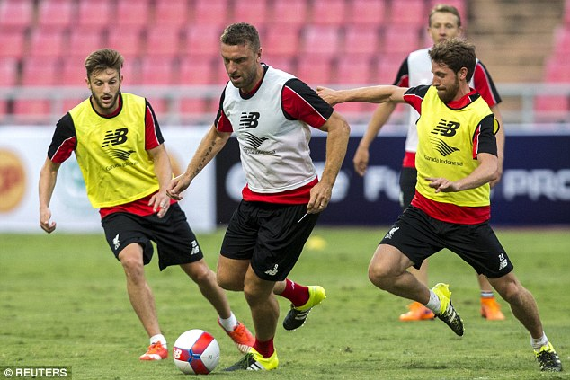 Lambert tries to break away from Lallana and Allen as the Reds prepared for their opening fixture on tour