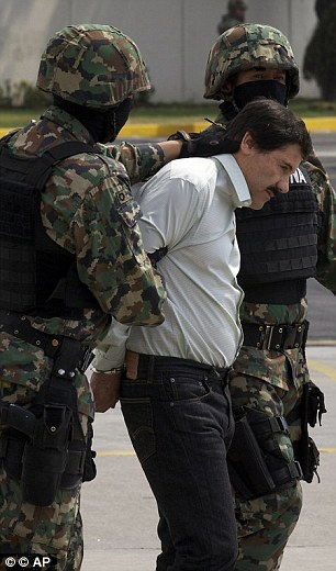 Drug lord Joaquin Guzman during his capture last year