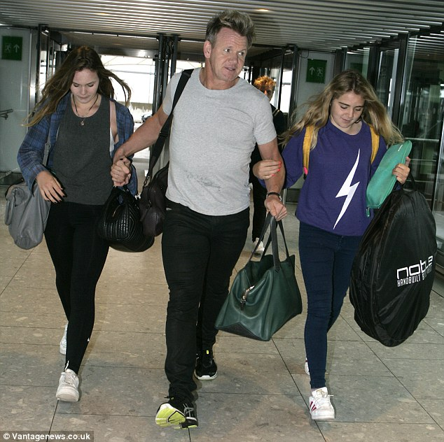 No nightmares here: Gordon Ramsay looked as if he was having a dream trip as he jetted off from London's Heathrow Airport with his family on Monday afternoon