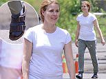 EXCLUSIVE: Amy Adams is all smiles on the Montreal set of 'Story of Your Life.' Looking casual in a t-shirt, track pants with wool sock and Birkenstock sandals, Amy walks to set.    Pictured: amy adams Ref: SPL1083695  200715   EXCLUSIVE Picture by: Splash News  Splash News and Pictures Los Angeles: 310-821-2666 New York: 212-619-2666 London: 870-934-2666 photodesk@splashnews.com