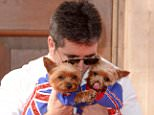 Mandatory Credit: Photo by David Fisher/REX Shutterstock (3688636br).. Simon Cowell with dogs Squiddly and Diddly.. 'Britain's Got Talent' photocall, London, Britain - 09 Apr 2014.. ..