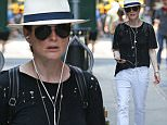 Julianne Moore walking in the New York heat wearing a ripped black shirt\n\nPictured: Julianne Moore\nRef: SPL1082216  200715  \nPicture by: Splash News\n\nSplash News and Pictures\nLos Angeles: 310-821-2666\nNew York: 212-619-2666\nLondon: 870-934-2666\nphotodesk@splashnews.com\n