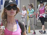 Picture Shows: Lola Sheen, Sam Sheen, Denise Richards  July 19, 2015\n \n Actress Denise Richards takes her daughters Sam and Lola to ride horses at the Los Angeles Equestrian Center in Los Angeles, California.\n \n Exclusive All Rounder\n UK RIGHTS ONLY\n \n Pictures by : FameFlynet UK © 2015\n Tel : +44 (0)20 3551 5049\n Email : info@fameflynet.uk.com