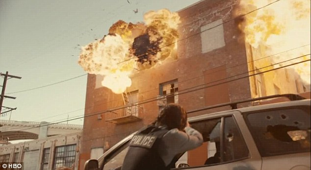 Explosive development: Ray took cover as a building exploded while pursing the prime suspect in the case