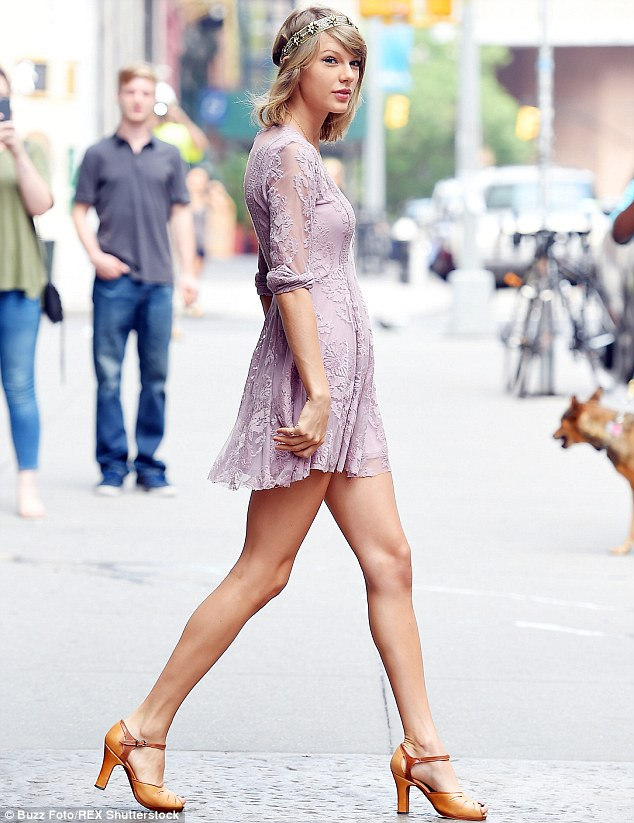 Showing her Style: She also wore a shimmering gold headband and brown leather heels