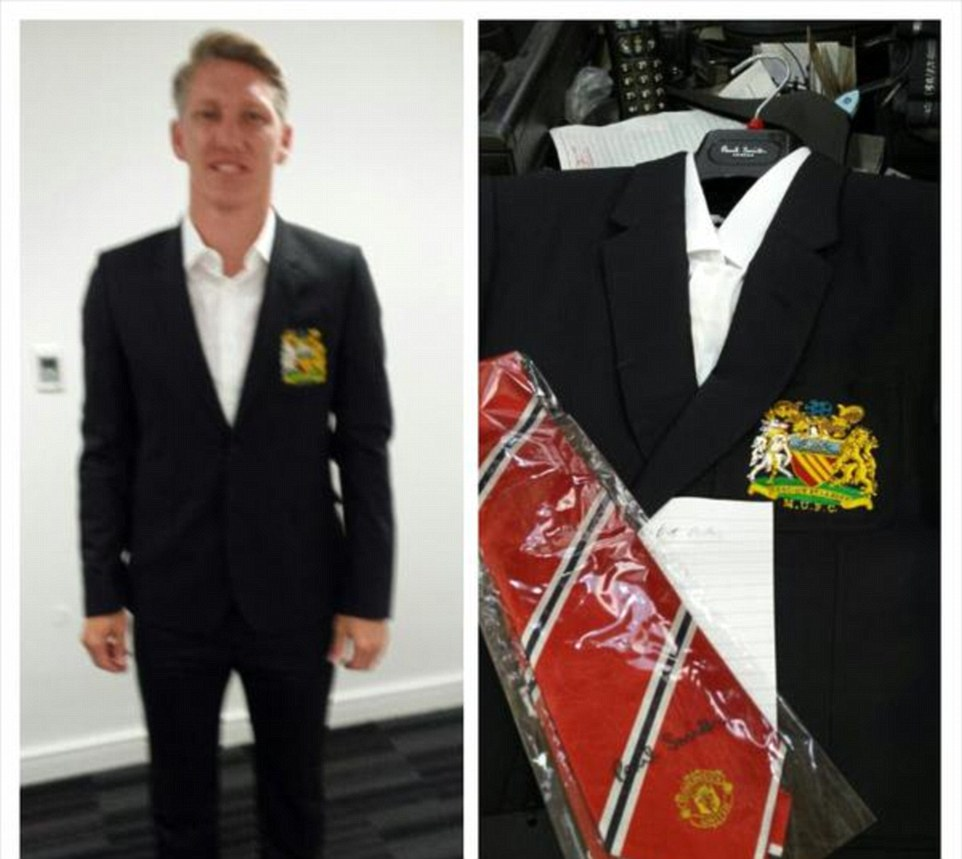 The German World Cup winner is fitted out in his new suit, complete with club tie and blazer