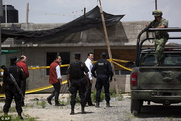 What's next? Mexico's Interior Secretary Miguel Angel Osorio Chong, white shirt, walks through the escape scene with authorities on Monday