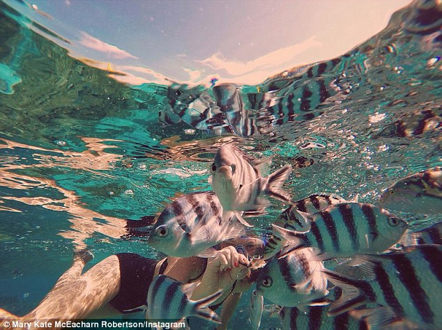 Trip of a lifetime: In one of the stunning snaps, Mary Kate is seen swimming with tropical fish