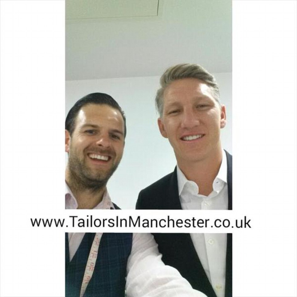 Schweinsteiger poses with the club's tailor after signing a three-year deal with Manchester United and leaving on their pre-season tour