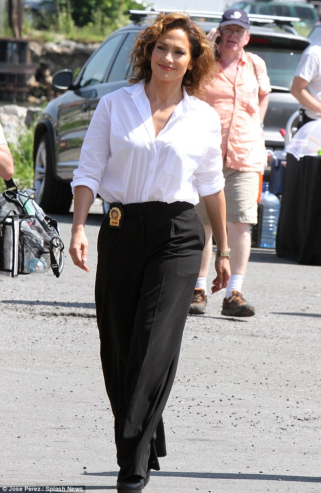 Changing it up: The Latino beauty ditched her typically glamorous style for a pair of black palazzo pants and a loose-fitting white blouse as she filmed scenes in a parking lot in Queens, New York on Friday
