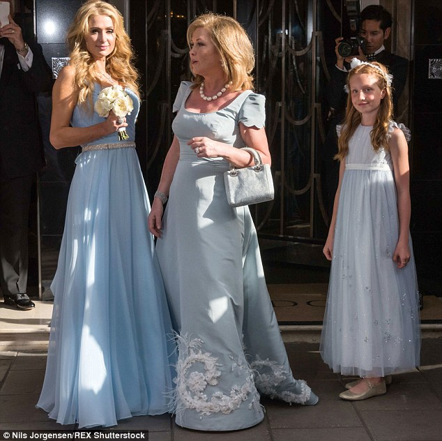 Pretty: One of the flower girls stands with mother of the bride Kathy Hilton and bridesmaid Paris Hilton