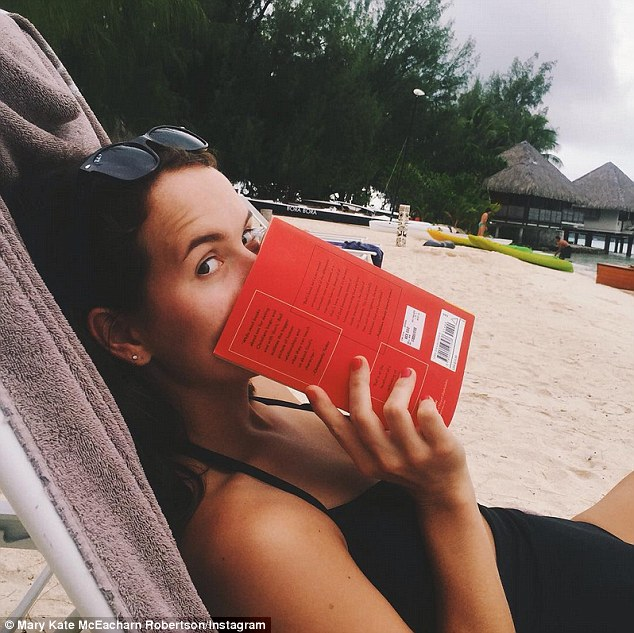 'honeymoon part 2, day 3': Mary Kate got in some holiday reading at their waterside resort
