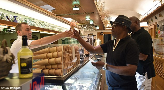 Yummy: The Avengers star and the basketball legend picked out flavors at the local store in the upscale resort