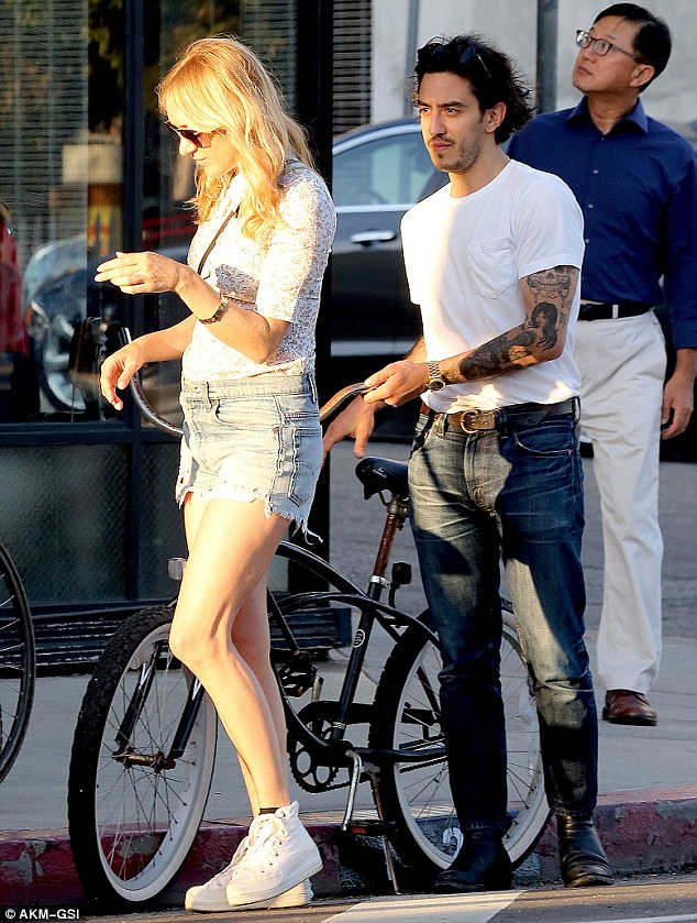 Sunday stroll: Chloe Sevigny and her new mystery man were spotted in Venice on Sunday on a bike ride to Venice Market thenlater headed to dinner at Gjelina