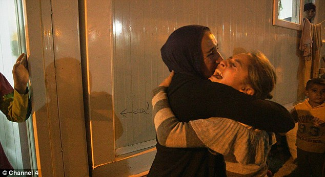 A young girl who was abducted by ISIS is reunited with her family at a refugee camp in northern Iraq