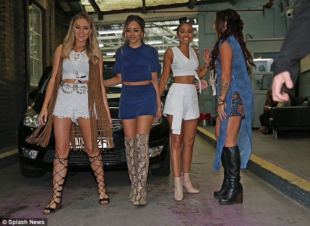 Having fun:Jade opted for a navy co-ord by Gyunel and snakeskin boots and Jesy went for a pattered jumpsuit and knee-high leathers