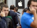 People queue to buy the last iPhone 6 in front of the Apple Store of the Puerta del Sol in Madrid, Spain.  The iPhone 6 and iPhone 6 Plus were launched on September 19, 2014 in the United States, Britain, Australia, Canada, France, Germany, Hong Kong, Japan, Puerto Rico and Singapore. The iPhone 6 is available in more than 20 additional countries since today, and 115 countries by the end of the year.    AFP PHOTO/ GERARD JULIEN         (Photo credit should read GERARD JULIEN/AFP/Getty Images)
