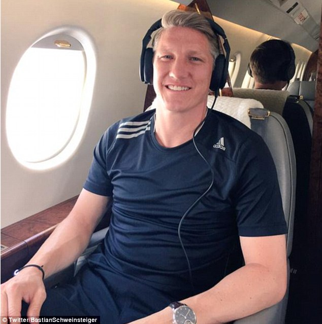 Schweinsteiger poses on a plane as he flies to Manchester Airport to complete a move to United