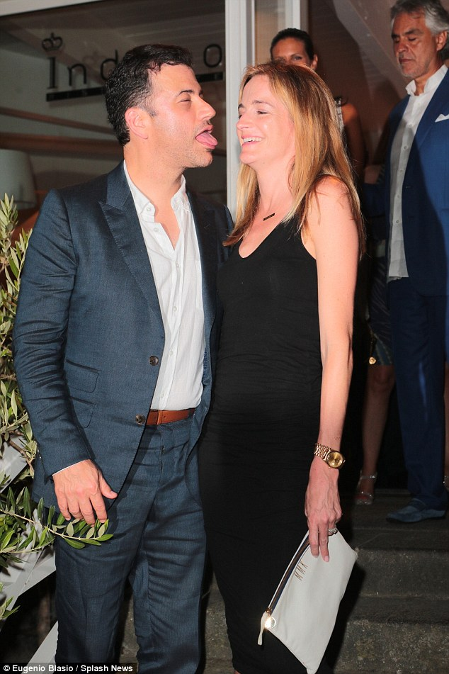 Lick you: Jimmy Kimmel stuckk his tongue out at wife Molly McNearney as he arrived at the festival awards show on the Italian island of Ischia on Sunday night