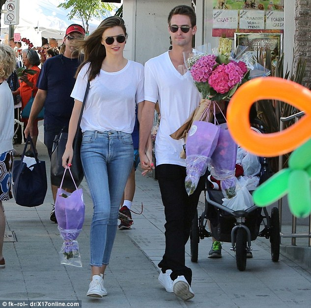 Out and about: Miranda Kerr and Evan Spiegel were spotted together on Sunday