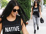 Kourtney Kardashian wears a shirt that reads NATIVE with straight dark shades and hair. Looking in a bad mood over breaking up with Scott but does some retail therapy at Trico Field, picking up some presents for her kids July 20, 2015 X17online.com