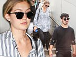 20 Jul 2015 - LOS ANGELES - USA  GIGI HADID & JOE JONAS AT LAX.   BYLINE MUST READ : XPOSUREPHOTOS.COM  ***UK CLIENTS - PICTURES CONTAINING CHILDREN PLEASE PIXELATE FACE PRIOR TO PUBLICATION ***  **UK CLIENTS MUST CALL PRIOR TO TV OR ONLINE USAGE PLEASE TELEPHONE  44 208 344 2007 ***