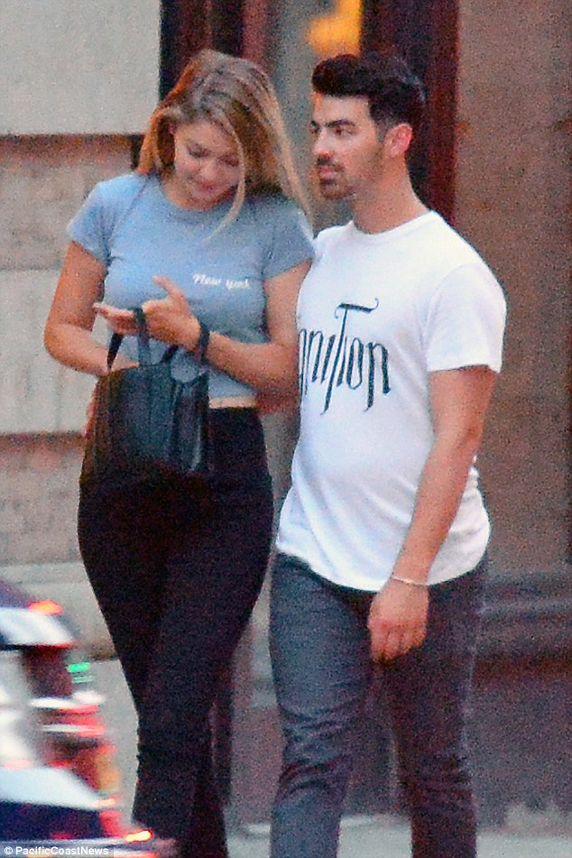 Content couple: The duo looked relaxed and casual in T-shirts for the outing