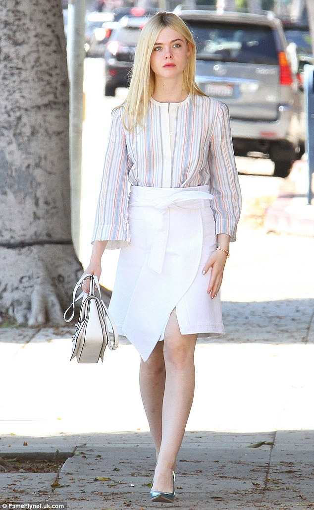 Impeccably dressed: Elle Fanning, 17, cut an elegant figure when she stepped out in Beverly Hills, California, on Sunday in a white skirt and striped shirt