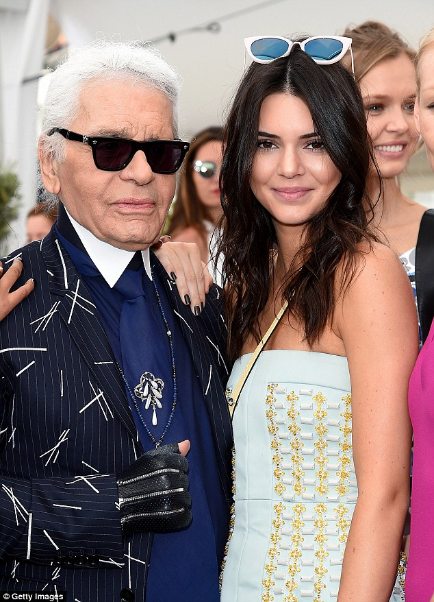 Moving on up: Despite the criticisms, many believe Kendall is the next runner up for a Chanel campaign - following in the footsteps of Cara Delevingne and Blake Lively (pictured: Kendall with Karl Lagerfeld)