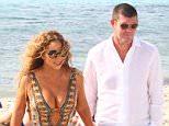 Mariah Carey and James Packer arriving on the beach in Formentera, Spain.....Pictured: Mariah Carey and James Packer..Ref: SPL1065792  010715  ..Picture by: blocco / Splash News....Splash News and Pictures..Los Angeles: 310-821-2666..New York: 212-619-2666..London: 870-934-2666..photodesk@splashnews.com..
