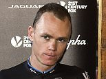 Great Britain's Christopher Froome, the overall leader's yellow jersey, gives a press conference at his hotel, next to Sky Head of Athlete Performance Tim Kerrison (L), and Sky team principal Sir Dave Brailsford (R), during a rest day as part of the 102nd edition of the Tour de France cycling race on July 21, 2015, in Sisteron, southern France.  AFP PHOTO / ERIC FEFERBERGERIC FEFERBERG/AFP/Getty Images