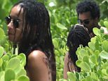 *** UK ONLY *** *** MAIL ONLINE OUT ***140016, NO ORDINARY LOVE! Zoe Kravitz kisses her new boyfriend musician George Lewis Jr AKA Twin Shadow in Miami. The 26 year old, dressed in just a black bikini, was met at her hotel by her new man Twin Shadow. This is the first time the pair have been seen in public as a couple and clearly Zoe was very happy to see him, greeting him with a kiss. Zoe and George have been seen together once before but on a professional level, performing a cover of Sade's 'No Ordinary Love' on 'Late Night with Seth Meyers' back in May with her band Lolawolf.  Miami, Florida - Sunday July 12, 2015.\\n\\nPHOTOGRAPH BY Pacific Coast News / Barcroft Media\\n\\nUK Office, London.\\nT +44 845 370 2233\\nW www.barcroftmedia.com\\n\\nUSA Office, New York City.\\nT +1 212 796 2458\\nW www.barcroftusa.com\\n\\nIndian Office, Delhi.\\nT +91 11 4053 2429\\nW www.barcroftindia.com