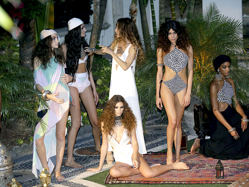 Designer Mara Hoffman, third from left, poses with her models before the Mara Hoffman swimwear show at Casa Casuarina as part of Funkshion Fashion Week Swim in Miami Beach. (AP Photo/Lynne Sladky)
