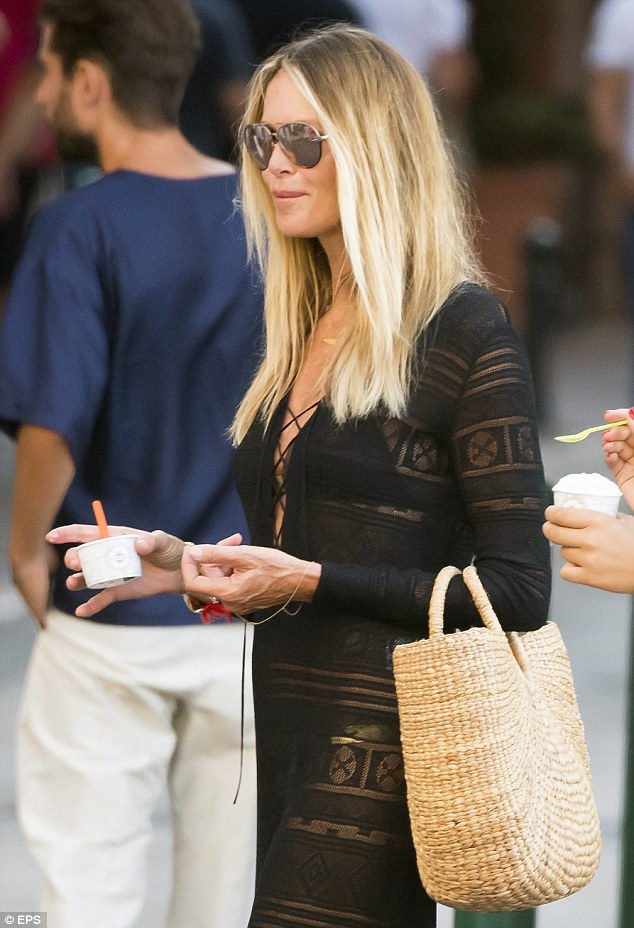 Got a sweet tooth Elle? 'The Body' Macpherson devours a tub of ice creams as she enjoys a romantic stroll with her husband in St Tropez on Sunday
