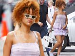 """EXCLUSIVE: Rihanna seen in pink shorts and tank top while carrying her dog """"Pepe"""" as she seen coming back to her apartment after spending weekend in the Hamptons, NYC  Pictured: Rihanna Ref: SPL1081994  200715   EXCLUSIVE Picture by: Splash News  Splash News and Pictures Los Angeles: 310-821-2666 New York: 212-619-2666 London: 870-934-2666 photodesk@splashnews.com"""