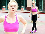 July 21, 2015: Elle Fanning shows off her toned bod in a sports bra and workout tights today in Hollywood, California today.\nMandatory Credit: Lek/INFphoto.com Ref: infusla-298