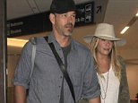 EXCLUSIVE: LeAnn Rimes & Eddie Cibrian are spotted holding hands as they arrive in Los Angeles shortly after LeAnn Rimes tweets they had to land at another airport to refuel their plane.   Pictured: LeAnn Rimes, Eddie Cibrian Ref: SPL1083990  200715   EXCLUSIVE Picture by: Splash News  Splash News and Pictures Los Angeles: 310-821-2666 New York: 212-619-2666 London: 870-934-2666 photodesk@splashnews.com
