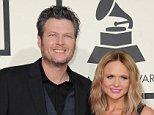 (FILES) In this February 8, 2015 file photo, nominee Miranda Lambert arrives with husband Blake Shelton on the red carpet for the 57th Annual Grammy Awards in Los Angeles. Country music superstars Blake Shelton and Miranda Lambert, the ultimate power couple in Nashville, are divorcing after four years of marriage, reports said July 20, 2015. In a breakup that can be expected to inspire future country ballads, the 39-year-old Shelton and the 31-year-old Lambert reportedly filed for divorce in Oklahoma. Celebrity news website TMZ said that Lambert has been moving her animals including horses, a camel and a llama from the couple's Oklahoma ranch, which Shelton will keep.AFP PHOTO / VALERIE MACONVALERIE MACON/AFP/Getty Images