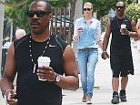 """Picture Shows: Eddie Murphy, Paige Butcher  July 21, 2015    Comedic actor Eddie Murphy and his girlfriend Paige Butcher make a morning coffee run to the Coffee Bean on July 21, 2015 in Studio City, California.      Eddie's long awaited """"Beverly Hills Cop 4"""" film will be waiting a little longer, as it was recently taken off of Paramount's release schedule.      UK Rights Only  EXCLUSIVE ALL ROUNDER  FameFlynet UK © 2015  Tel : +44 (0)20 3551 5049  Email : info@fameflynet.uk.com"""