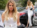 Khloe wearing a tight white skirt and heels and Kourtney wearing a tight beige dress and heeled boots taking Mason to lunch while her estranged ex Scott Disick getting slammed on social media after accepting Vegas party event offer . July 21, 2015 X17online.com